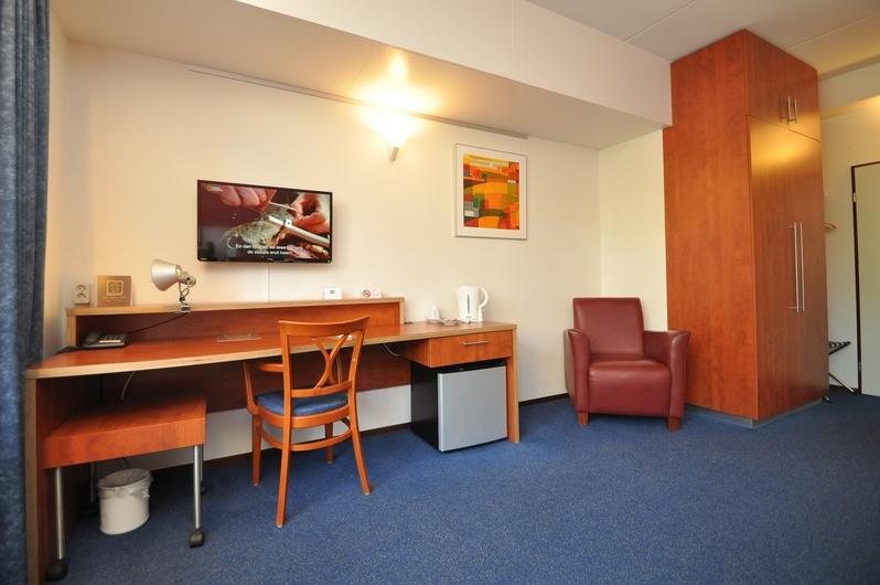 Bureau en zithoek - Hotelkamers Hotel De Meulenhoek